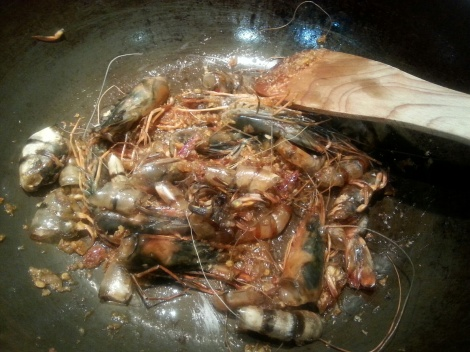 frying the prawn shells in the chilli paste